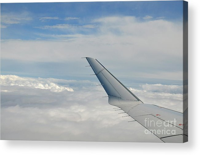 Freedom Acrylic Print featuring the photograph Wings Of Flying Airplane Over Clouds by Sami Sarkis