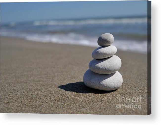 Stability Acrylic Print featuring the photograph Stack Of Pebbles On Beach by Sami Sarkis