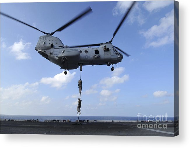Fast Rope Acrylic Print featuring the photograph A Trio Of Marines Fast Rope by Stocktrek Images