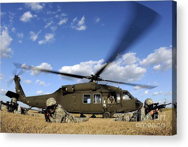 Us Air Force Acrylic Print featuring the photograph Airmen Provide Security In Front by Stocktrek Images