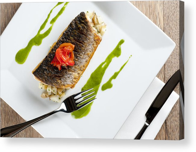 Grey Mullet Acrylic Print featuring the photograph Grey Mullet With Watercress Sauce Presented On A Square White Plate With Cutlery And Napkin by Andy Smy