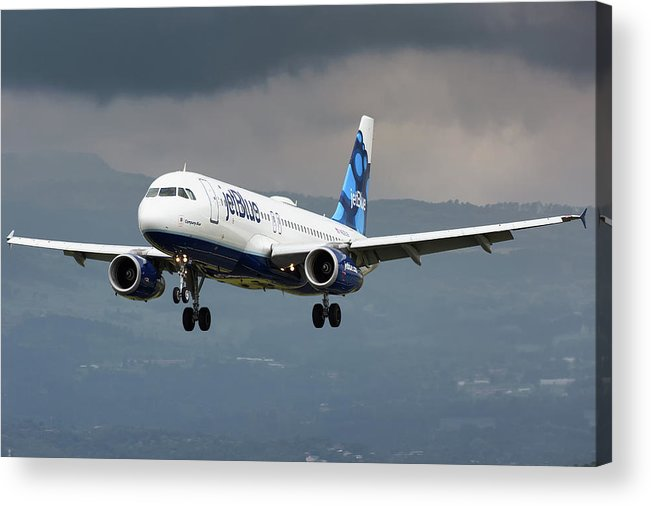 Jetblue Airways Airbus A320 Landing San Jose Costa Rica Mroc Sjo Aviation Airplane Landing Acrylic Print featuring the photograph jetBlue A320 landing with mountain by Andres Meneses