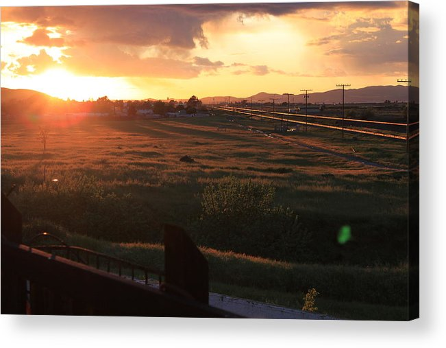 Sunset Acrylic Print featuring the photograph Sunset On The Railroad Track by Remegio Onia