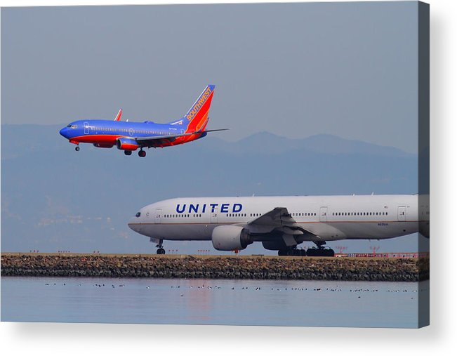 Southwest Acrylic Print featuring the photograph United Airlines And Southwest Airlines Jet Airplane At San Francisco International Airport Sfo.12087 by Wingsdomain Art and Photography