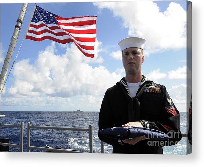 Burial At Sea Acrylic Print featuring the photograph A Sailor Carries The National Ensign by Stocktrek Images