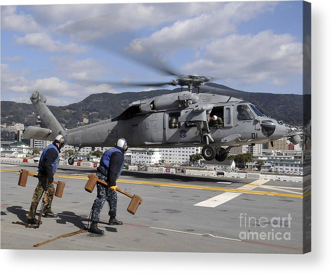 Chocks Acrylic Print featuring the photograph Airmen Prepare To Chock And Chain An by Stocktrek Images