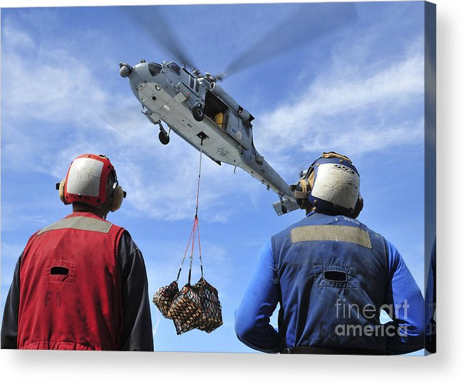 Cargo Acrylic Print featuring the photograph Flight Deck Personnel Wait For Supplies by Stocktrek Images