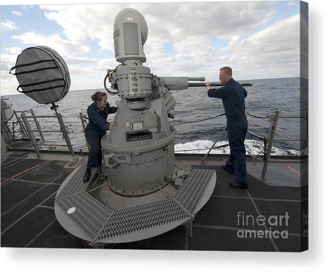 Military Acrylic Print featuring the photograph Sailors Conduct Maintenance On The Mk38 by Stocktrek Images