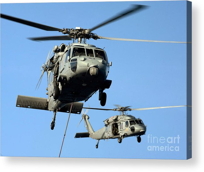 Clear Sky Acrylic Print featuring the photograph Mh-60s Sea Hawk Helicopters In Flight by Stocktrek Images