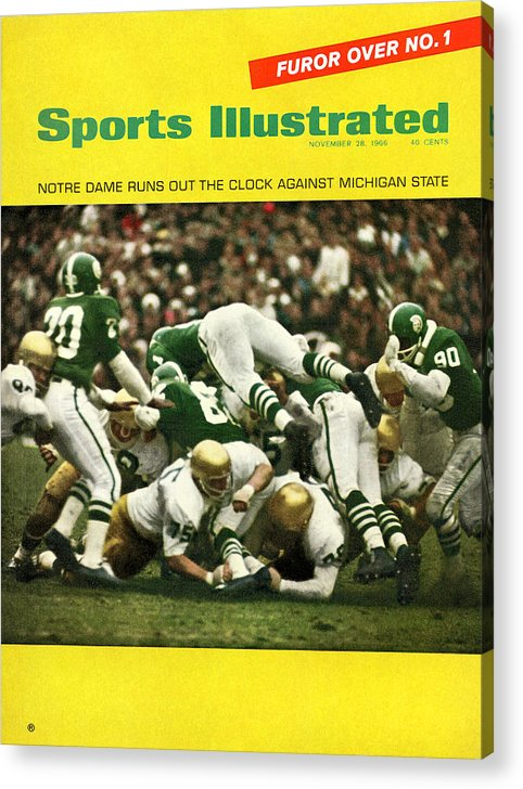 Michigan State University Acrylic Print featuring the photograph University Of Notre Dame Football Sports Illustrated Cover by Sports Illustrated