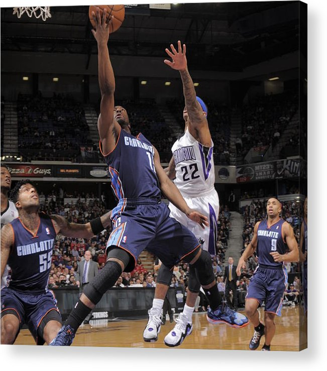Kemba Walker Acrylic Print featuring the photograph Kemba Walker and Isaiah Thomas by Rocky Widner
