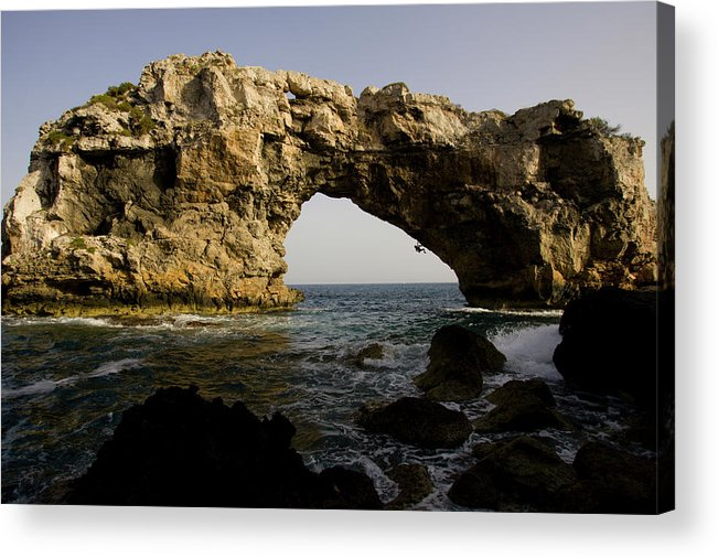 Action Acrylic Print featuring the photograph A Man Rock Climbing Deep Water Soloing by Corey Rich