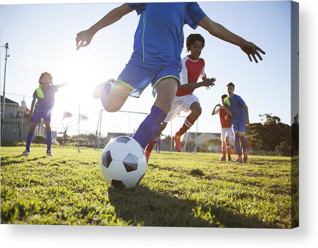 Grass Acrylic Print featuring the photograph Close up of boy kicking soccer ball by Alistair Berg