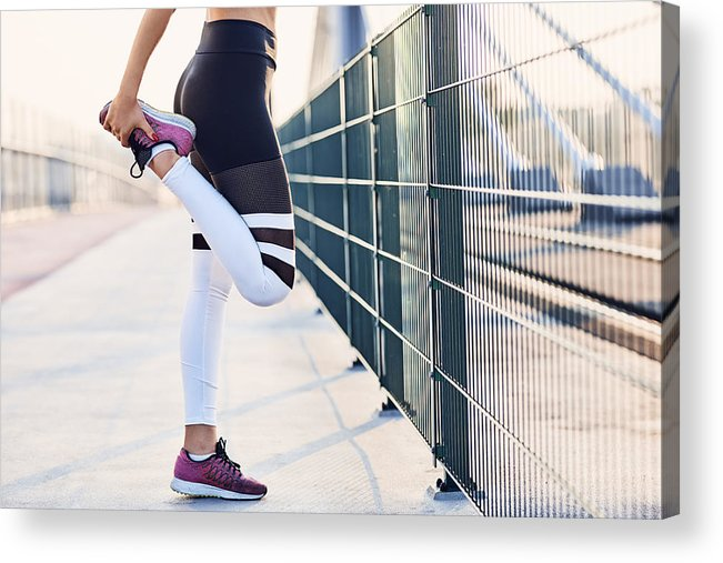 Recreational Pursuit Acrylic Print featuring the photograph Close-up of woman stretching legs after running by Westend61