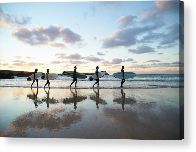 Young Men Acrylic Print featuring the photograph Five Surfers Walk Along Beach With Surf by Dougal Waters