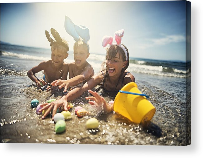 Easter Bunny Acrylic Print featuring the photograph Kids playing in sea during summer Easter by Imgorthand