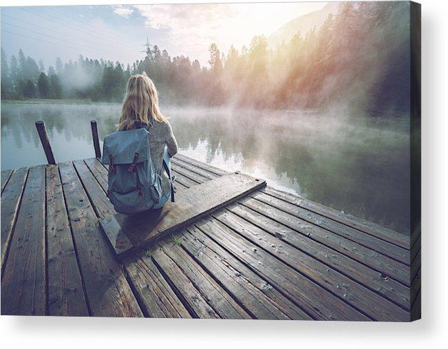 Tranquility Acrylic Print featuring the photograph Mountain girl enjoying morning fog from lake pier, sun rising by Swissmediavision
