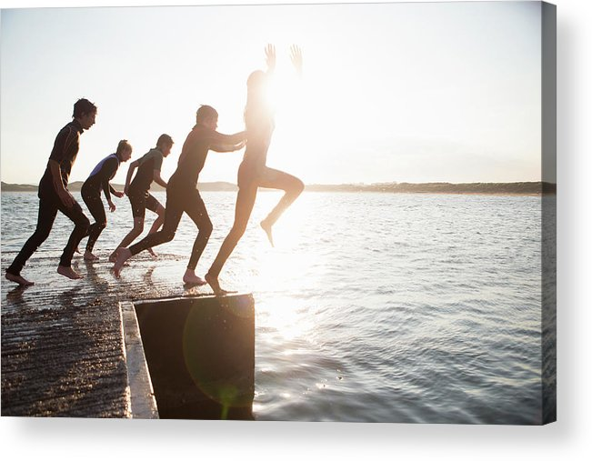 Adolescence Acrylic Print featuring the photograph Pier Jumping by Solstock
