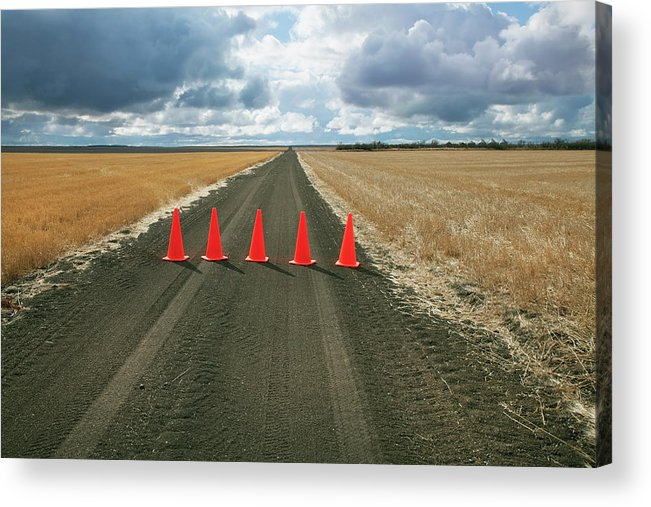 Orange Color Acrylic Print featuring the photograph Safety Cones Lined Up Across A Rural by Benjamin Rondel / Design Pics