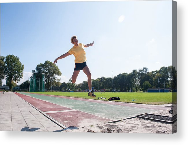 North Holland Acrylic Print featuring the photograph Senior Athlete (75) Practicing Long Jump by Lucy Lambriex
