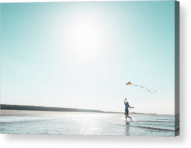 Three Quarter Length Acrylic Print featuring the photograph Woman Flying Kite On Beach by Dan Brownsword