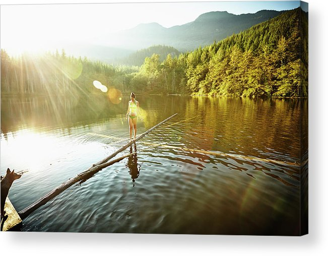 Pets Acrylic Print featuring the photograph Woman Walking On Log In Alpine Lake by Thomas Barwick