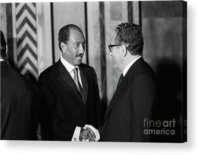 Mature Adult Acrylic Print featuring the photograph Anwar Sadat And Henry Kissinger by Bettmann