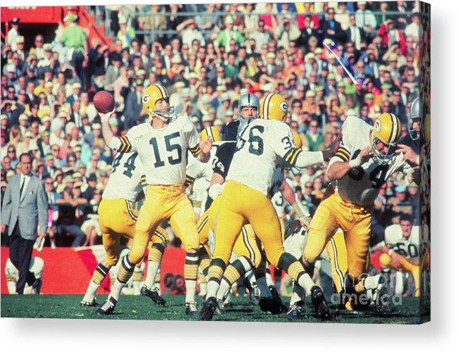 American Football Uniform Acrylic Print featuring the photograph Bart Starr Passing The Ball by Bettmann