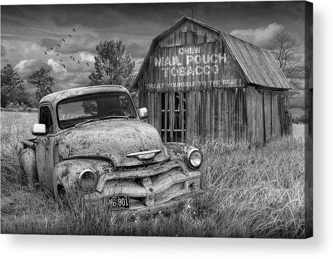 Chevy Acrylic Print featuring the photograph Black And White Of Rusted Chevy Pickup Truck In A Rural Landscape By A Mail Pouch Tobacco Barn by Randall Nyhof