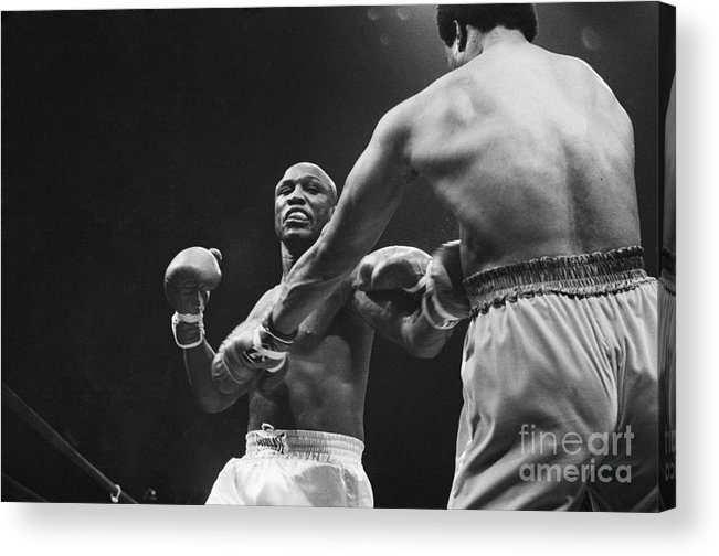 Joe Frazier Acrylic Print featuring the photograph Boxers Joe Frazier And George Foreman by Bettmann