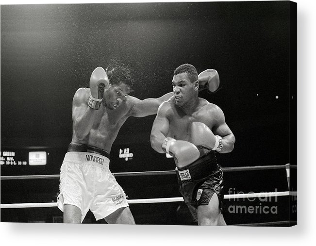 1980-1989 Acrylic Print featuring the photograph Mitch Green Recoils From Mike Tysons by Bettmann