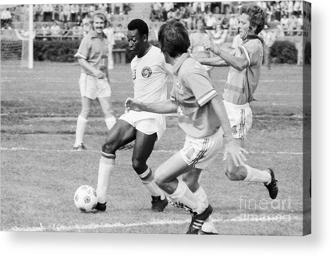 Pelé Acrylic Print featuring the photograph Pele Running With Soccer Ball by Bettmann