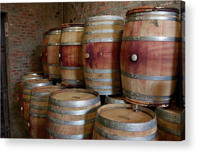 Stellenbosch Acrylic Print featuring the photograph Pile Of Wooden Barrels At Winery by Klaus Vedfelt