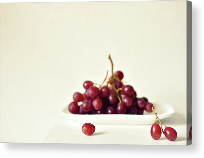 White Background Acrylic Print featuring the photograph Red Grapes On White Plate by Photo By Ira Heuvelman-dobrolyubova