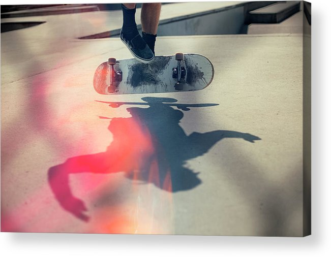 Cool Attitude Acrylic Print featuring the photograph Skateboarder Doing An Ollie by Devon Strong