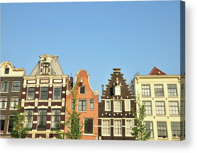 In A Row Acrylic Print featuring the photograph Typical Canal Houses, Amsterdam, The by Gorazdbertalanic