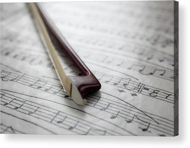 Sheet Music Acrylic Print featuring the photograph Violin Bow On Music Sheet by Daniel Allan
