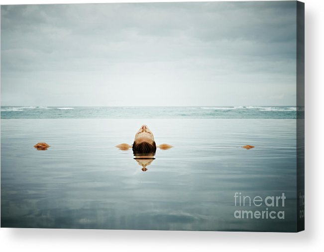 People Acrylic Print featuring the photograph Woman Floating On Back In Infinity Pool by Thomas Barwick