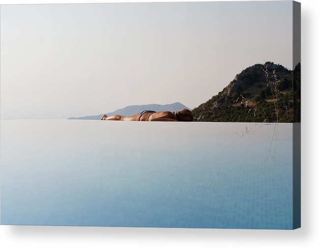 Tranquility Acrylic Print featuring the photograph Woman Laying On Edge Of Infinity Pool by J.a. Bracchi