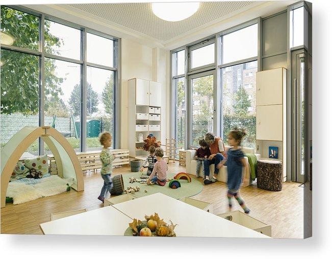Toddler Acrylic Print featuring the photograph Pre-school teacher and children in playing in learning room in kindergarten by Westend61
