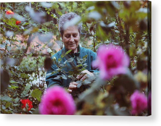 Working Acrylic Print featuring the photograph Woman With Flowers In The Garden by Tolgart