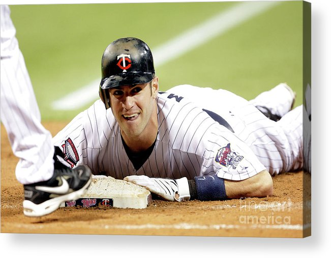 Hubert H. Humphrey Metrodome Acrylic Print featuring the photograph Joe Mauer by Jamie Squire