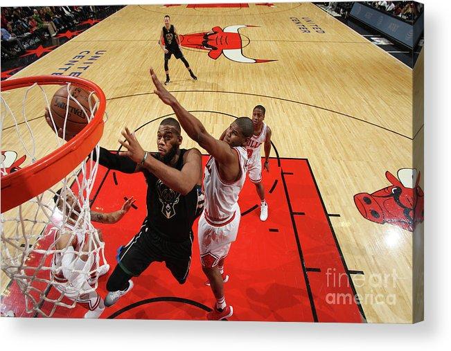 Nba Pro Basketball Acrylic Print featuring the photograph Greg Monroe by Gary Dineen