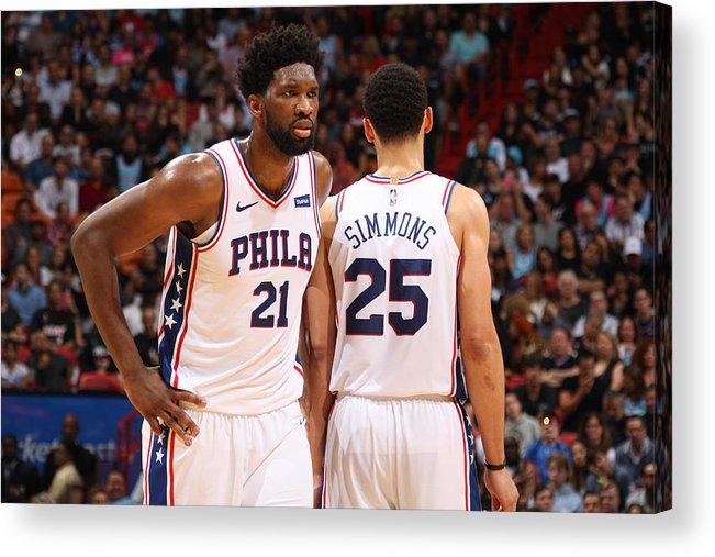 Nba Pro Basketball Acrylic Print featuring the photograph Ben Simmons and Joel Embiid by Oscar Baldizon