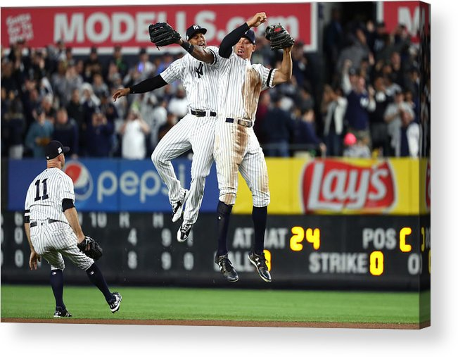 Playoffs Acrylic Print featuring the photograph Brett Gardner, Aaron Judge, and Aaron Hicks by Al Bello