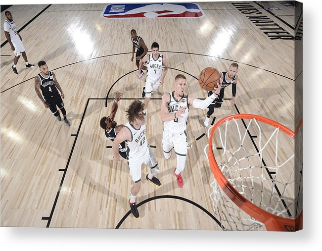 Nba Pro Basketball Acrylic Print featuring the photograph Brooklyn Nets v Milwaukee Bucks by David Dow
