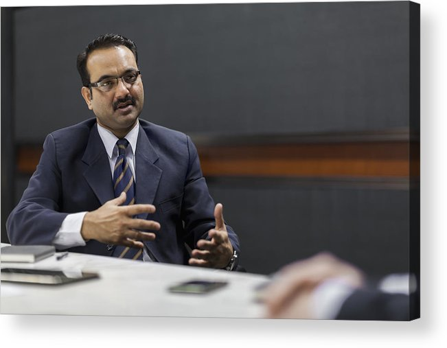 Corporate Business Acrylic Print featuring the photograph Businessman explaining idea in office meeting by Shannon Fagan
