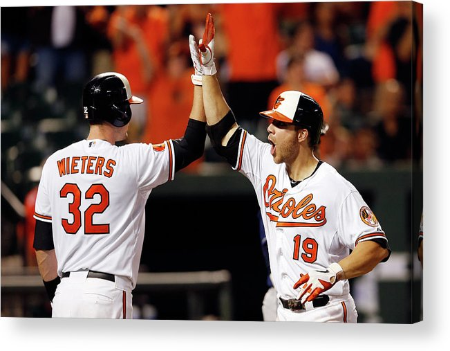 American League Baseball Acrylic Print featuring the photograph Chris Davis and Matt Wieters by Rob Carr