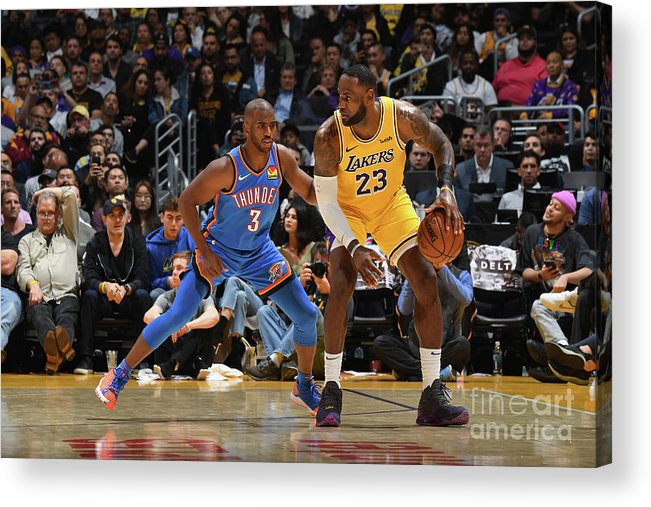 Nba Pro Basketball Acrylic Print featuring the photograph Chris Paul and Lebron James by Andrew D. Bernstein