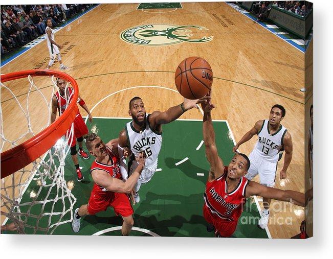 Nba Pro Basketball Acrylic Print featuring the photograph C.j. Mccollum and Greg Monroe by Gary Dineen